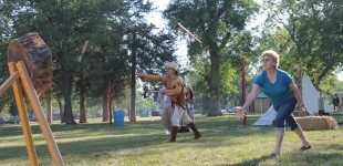 Rose Sleezer, Emporia, and Paul Houston, Manhattan, throw tomahawks at a target during an event hosted by Marauders, a living historian group, at the Americus Days Festival.