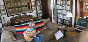 "Songwriter Annie Wilson tells her love story through her song, ""Diamond Creek Cowboy,"" which she wrote about her rancher husband, John Wilson. The Wilsons live on a ranch near Elmdale. Wilson performed her songs about the Flint Hills at the storytelling circle after the symphony on Saturday."