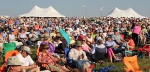 The crowd gathers just before the start of the 7th annual Symphony in the Flint Hills concert. The event was held in Leet Pasture near the small town of Bushong, Kan. (Photo by Amy DeVault)