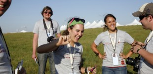 WSU student Erin Snodgrass laughs with other members of the Flint Hills Media Project the day before the symphonhy. Photo by Cary Conover
