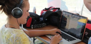 Hali Rowland edits a video package for KWCH TV  in the media tent at Symphony in the Flint Hills Saturday, June 9, 2012. Photo by Amy DeVault