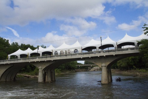Tents are set up for the 8th annual River Suite event held in Cottonwood Falls, Friday, June 12. The event takes place on an old bridge and sells out of tickets every year. Photo by Kristin Khosravipour