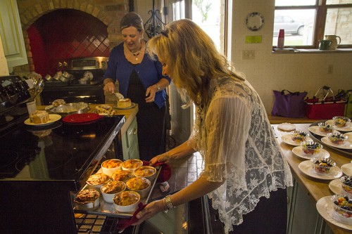Susie Harshman, co-owner of the Clover Cliff B&B in Elmdale, pulls breakfast casserole from the oven to serve guests at the Clover Cliff bed and breakfast, Saturday, June 13. Photo by Kristin Khosravipour