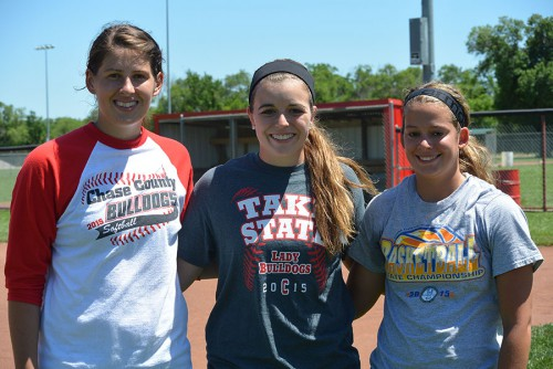 Megan Jirak, Tori Burkhart and Brianna Potter celebrate winning four state championships during their high school softball career for Chase County Softball Team. All three girls plan on attending college in the fall. Photo by Chandler Williams