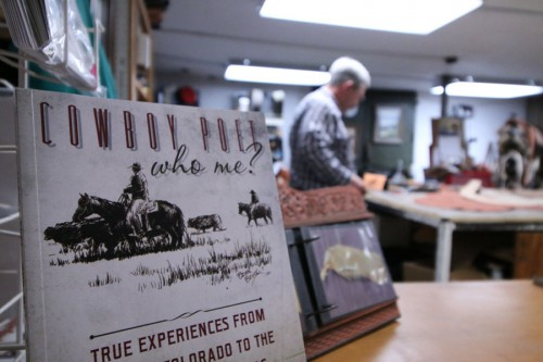 Bruce Brock, Cottonwood Falls, published a collection of cowboys and poems. Brock owns Brock's Boot & Saddle Repair, located inside of Salty Cow Mercantile in downtown Cottonwood Falls. Photo by Sean Jones