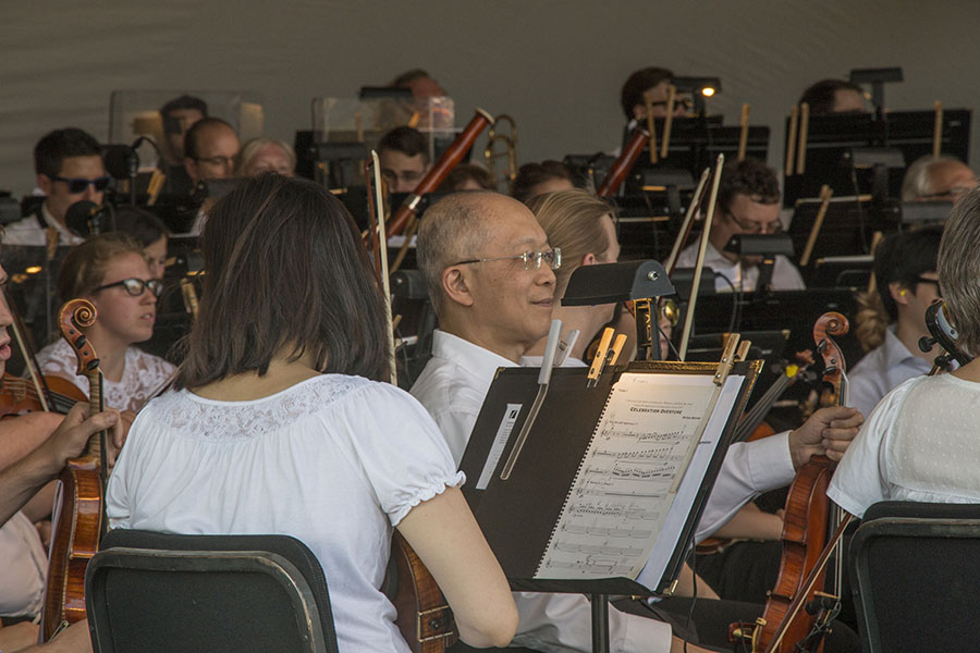 Alex Shum, violinist with the Kansas City Symphony, takes in the crowd moments before the 11th annual Symphony in the Flint Hills concert. Photo by Amy DeVault